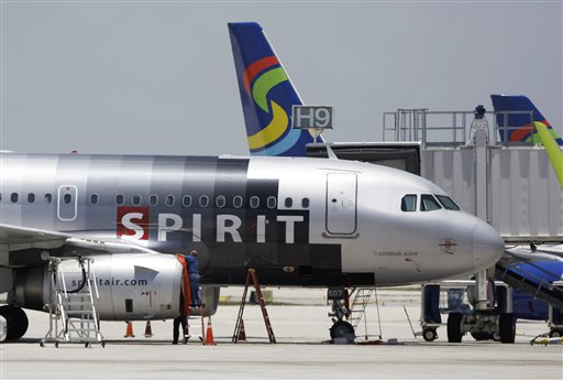 FILE - In this file photo taken June 13, 2010, a Spirit Airlines airplane sits on the tarmac at Fort Lauderdale-Hollywood International Airport in Fort Lauderdale, Fla. Spirit Airlines passengers may want to get to the airport a little earlier than normal Sunday as a new fee on carry-on bags takes effect. (AP Photo/Lynne Sladky, File)