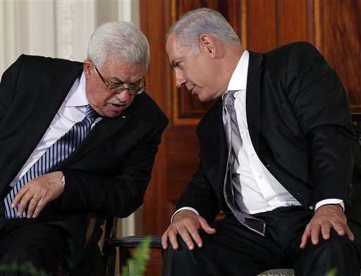 Palestinian President Mahmoud Abbas and Israeli Prime Minister Benjamin Netanyahu talk during remarks on the Middle East peace negotiations in the East Room of the White House in Washington, Wednesday, Sept. 1, 2010. (AP Photo/Pablo Martinez Monsivais)