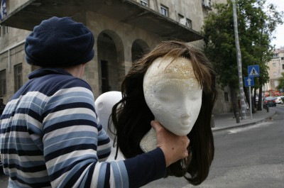 FILE - An Ultra Orthodox woman carrying a model wearing a wig crosses a street in Jerusalem. Photo by Nati Shohat /Flash90.