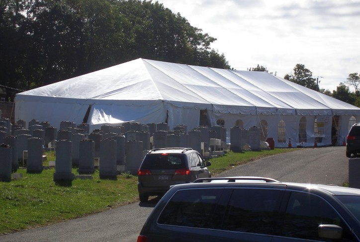 A large tent erected up seen early this morning where thousands decent to daven near the Kever Photo: Sandy Eller