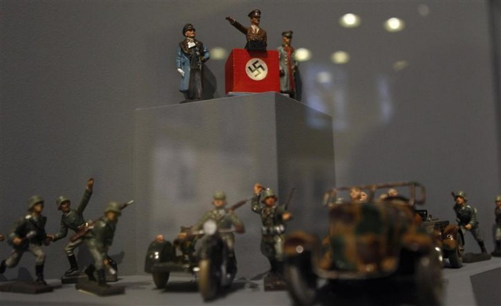 "Figures showing dictator Adolf Hitler and German Nazi soldiers are pictured at the media preview of the exhibition ""Hilter und die Deutsche Volksgemeinschaft und Verbrechen"" (Hitler and the German Nation and Crime) at the Deutsche Historisches Museum (German Historical Museum) in Berlin October 13, 2010. The exhibition will open to the public on October 15 and run till February 6, 2011.  REUTERS/Fabrizio Bensch"