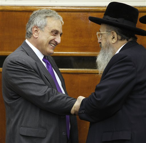 An Orthodox Jewish supporter, right, greets New York Republican gubernatorial candidate Carl Paladino before Paladino spoke during a campaign stop at the Karlsburg Rabbinical College in the Borough Park neighborhood of the Brooklyn borough of New York, Sunday, Oct. 10, 2010. (AP Photo/Kathy Willens)