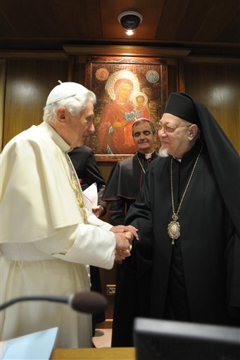 In this photo provided by the Vatican newspaper L'Osservatore Romano, Pope Benedict XVI, left, shakes hands with Coptic Catholic patriarch of Alexandria, Egypt, Antonios Naguib on the last day of the synod of bishops from the Middle East, at the Vatican, Saturday, Oct. 23, 2010. (AP Photo/L'Osservatore Romano