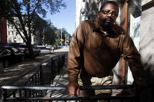In this photo taken Oct. 8, 2010, Charles Shepherd, wrongfully jailed for 14 years before another man confessed to the crime, stands outside his workplace in the Brooklyn borough of New York. (AP Photo/Bebeto Matthews)