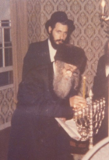 During Chanukah in Los Angels in 1975 seen in background Singer Mordchai Ben David who was many years the Gabi for the Rebbe