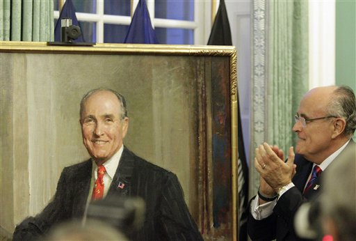Former Mayor Rudy Giuliani looks at the his portrait during its unveiling at City Hall Tuesday, Oct. 26, 2010  in New York.  (AP Photo/Frank Franklin II)