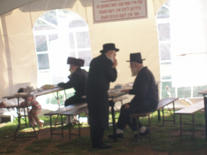 A man seen Sunday morning in the erected tent next to the Rebbes kever dressed with his Shtrimal, apparently the man arrived late last night Motzi Shabbos Photo: Sandy Eller
