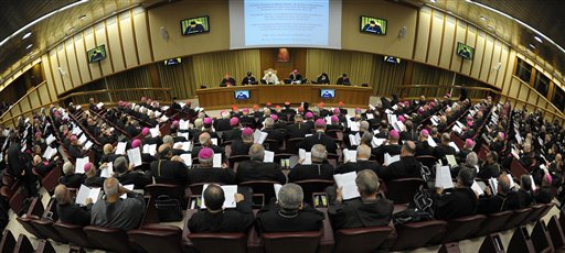 In this photo taken with a fish eye lens and provided by the Vatican newspaper L'Osservatore Romano, Pope Benedict XVI, background center, presides over the last day of the synod of bishops from the Middle East, at the Vatican, Saturday, Oct. 23, 2010. (AP Photo/L'Osservatore Romano)