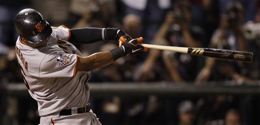 San Francisco Giants' Edgar Renteria hits a three run home run during the seventh inning of Game 5 of baseball's World Series against the Texas Rangers Monday, Nov. 1, 2010, in Arlington, Texas. (AP Photo/David J. Phillip)