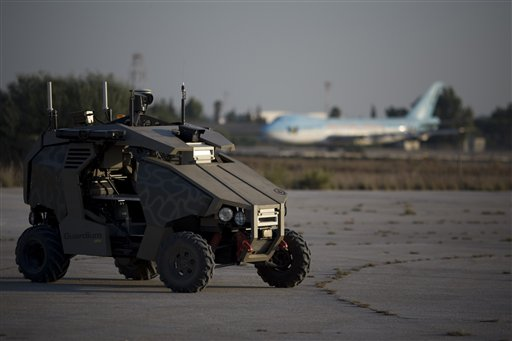 An unmanned vehicle helps secure the runway at Ben Gurion air port near Tel Aviv, Israel, Tuesday, Nov. 2, 2010. Senior Israeli airport official Nahum Liss said Tuesday screening procedures at airports around the world are inadequate, calling Israel's heavily fortified international airport the best protected in the world. (AP Photo/Ariel Schalit)