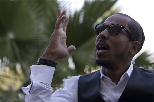 "In this photo taken Thursday Nov. 11, 2010 U.S. rapper Jamal ""Shyne"" Barrow gestures as he talks during an interview with the Associated Press in Jerusalem. After serving eight years in prison for a nightclub shooting, Shyne, the former protege of Sean ""P. Diddy"" Combs has converted to Orthodox Judaism, come to Jerusalem, and is devoting his days to the study of Torah while plotting a musical comeback. (AP Photo/Tara Todras-Whitehill)"