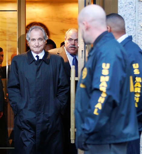 FILE - In this Jan. 5, 2009 file photo, Bernard Madoff leaves U.S. District Court in Manhattan after a bail hearing in New York. One of Bernard Madoff's sons was found dead of an apparent suicide Saturday, Dec. 11, 2010 on the second anniversary of his father's arrest. (AP Photo/Kathy Willens, File)