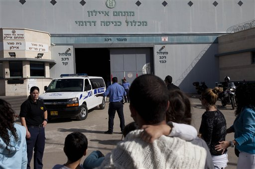 A van carrying Meir Abergil, a member of one of Israel's most notorious crime families, is driven from Ayalon prison at the central Israeli town of Ramle, Wednesday, Jan 12, 2011. Meir Abergil was taken from the prison to Israel's international airport where he and his brother Itzhak Abergil were extradited to the U.S., where they are wanted on charges ranging from murder to racketeering. (AP Photo/Oded Balilty)