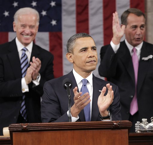 President Barack Obama is applauded by Vice President Joe Biden and House Speaker John Boehner of Ohio, prior to delivering his State of the Union address on Capitol Hill in Washington, Tuesday, Jan. 25, 2011.  (AP Photo/Pablo Martinez Monsivais, Pool)