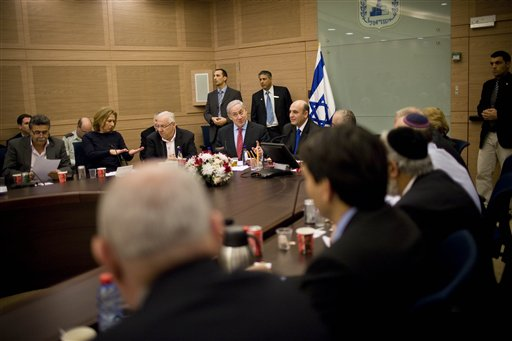 FILE - Israeli Prime Minister Benjamin Netanyahu, center, attends a Foreign Affairs and Security Committee meeting in the Knesset, Israel's parliament, in Jerusalem, Monday, Jan. 3, 2011. (AP Photos/Bernat Armangue)