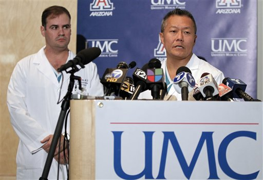 Dr. Peter Rhee, right, speaks about the condition of U.S. Rep. Gabrielle Giffords, D-Ariz., as Dr. G. Michael Lemole, Jr., looks on at University Medical Center during a news conference in Tucson, Ariz., Jan. 10, 2011. Giffords was shot in the head the Saturday during a speech at a local supermarket. (AP Photo/Chris Carlson)