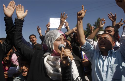 Yemeni students chant slogans calling on their president Ali Abdullah Saleh to leave the government and follow Tunisian ousted President Zine El Abidine Ben Ali into exile during a protest in Sanaa, Yemen, Saturday, Jan. 22, 2011.  (AP Photo/Hani Mohammed)