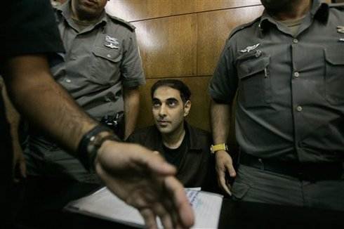 ** FILE ** In this file photo dated Nov. 1, 2007, Yigal Amir, the convicted assassin of late Israeli Prime Minister Yitzhak Rabin, is seen during a court hearing in Tel Aviv, Israel. Amir fatally shot Rabin at the end of a peace rally in Tel Aviv on Nov. 4, 1995. (AP Photo/Ariel Schalit, File)