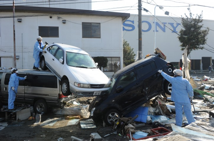Search and rescue workers look inside cars for survivors at Sendai Port 13 mARCH 2011 after a devastating earthquake and tsunami ravaged much of Japan's Pacific East coast on 11 March 2011, Sendai. Japanese police say that the number of people killed in the disaster could surpass 10,000  EPA/ALEX HOFFORD