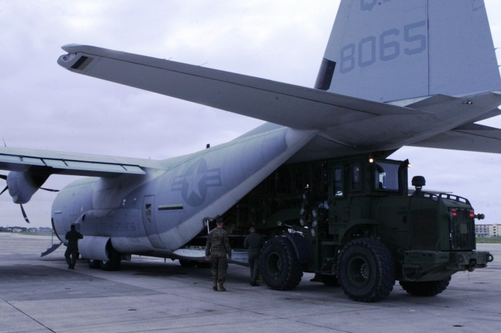 A handout picture provided by U.S. Marine Corps on 13 March 2011 shows Marines from III Marine Expeditionary Force as they load supplies and equipment onto a KC-130J Super Hercules aircraft at Marine Corps Air Station Futenma, in Okinawa, Japan, 13 March 2011. The supplies will be delivered to mainland Japan to be used in humanitarian assistance operations following the earthquake and tsunami that struck northern Japan, March 11. The proximity of Marine Corps aviation assets at MCAS Futenma has allowed Marines from III MEF to rapidly deploy critically-needed supplies and aid to support the relief effort.  EPA/CPL.