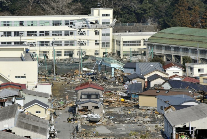 A rescue helicopter of Japan's Self-Defence Force  flies over a makeshift evacuation center over the tsunami-devastated area in  Ishinomaki is seen in Miyagi Prefecture, northern Japan, about 270km north of Tokyo,13 March, 2011 after strong earthquakes and tsunami killing more than 1,000 people were hitting northern Japan and Japanese capital of Tokyo area on 11 March.  EPA/KIMIMASA MAYAMA