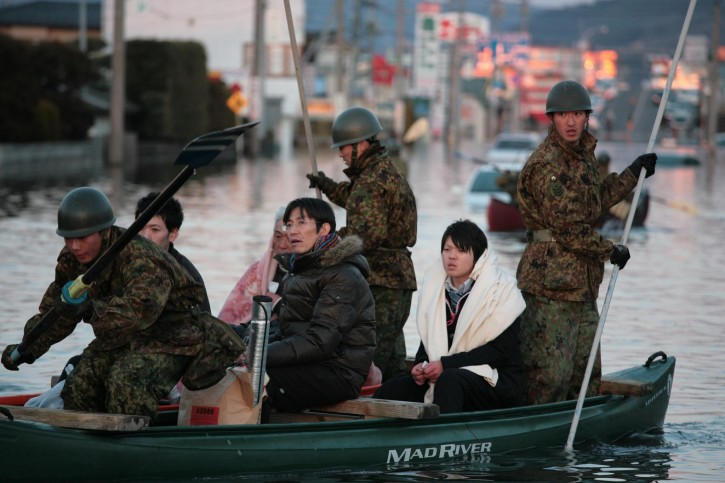 A handout photograph made available by the Japanese Red Cross on 13 March 2011 shows the military coordinating the transportation of those who need to be evacuated after the earthquakes and tsunamis, near Ishinomaki Red Cross hospital in Miyagi Prefecture, Japan, on 12 March 2011. A powerful earthquake hit Japan on 11 March 2011.  EPA/Toshiharu Kato