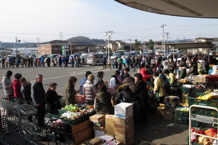 People queue up for food rations at a supermarket after a devastating earthquake and tsunami that ravaged much of Japan's Pacific East coast on 11 March 2011, Ogawara, Miyagi Prefecture, Japan, March 13 2011.  EPA/ALEX HOFFORD