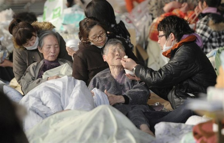 An elderly person has a meal at an evacuation centre in Kesennuma City, Miyagi Prefecture in northern Japan, after an earthquake and tsunami struck the area, March 13, 2011. Japan faces a growing humanitarian crisis on a scale not seen since World War Two after its devastating earthquake and tsunami left millions of people without water, electricity, homes or heat.   REUTERS/Kyodo