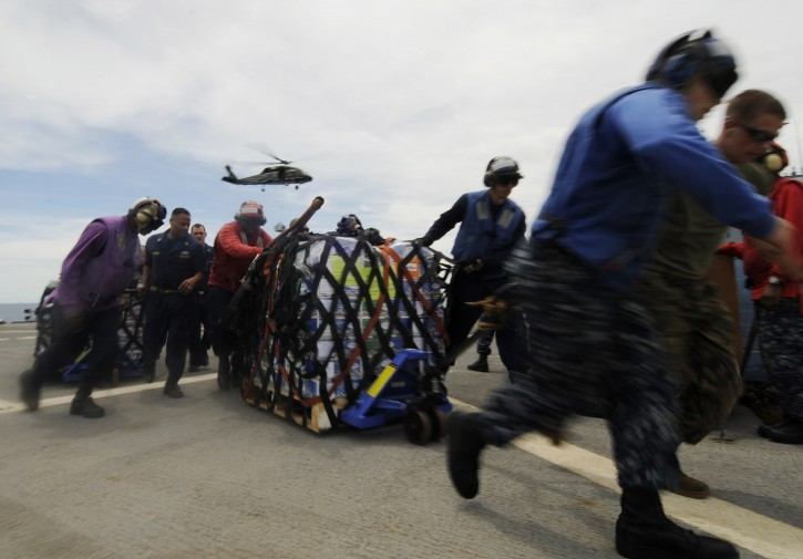 A handout picture provided by the Navy Visual News Service on 13 March 2011 shows sailors and marines aboard U.S. 7th Fleet command flagship USS Blue Ridge (LCC 19) as they move pallets of humanitarian assistance/disaster relief (HADR) kits across the ship's flight deck, during an underway replenishment with the fleet replenishment oiler USNS Rappahannock (T-AO 204) on 11 March 2011. Blue Ridge loaded another supply of humanitarian assistance/disaster relief kits to ensure the crew is ready to provide humanitarian assistance in of support earthquake and tsunami relief operations in Japan as directed.  EPA/