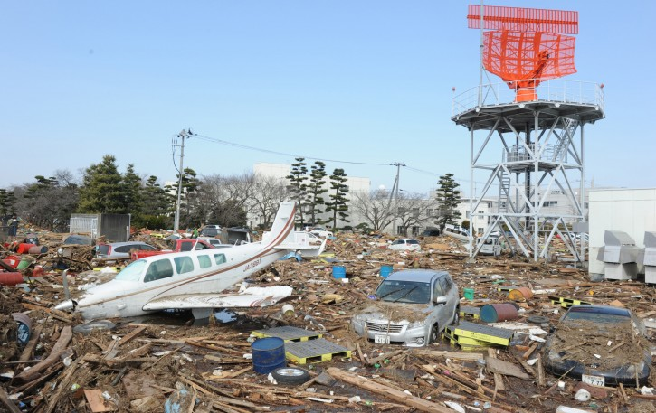 A light aircraft is seen in the rubble at Sendai airport after a devastating earthquake and tsunami that ravaged much of Japan's Pacific East coast on 11 March 2011, Natori, Miyagi Prefecture, Japan, March 13 2011. Japanese police say that the number of people killed in the disaster could surpass 10,000.  EPA/ALEX HOFFORD