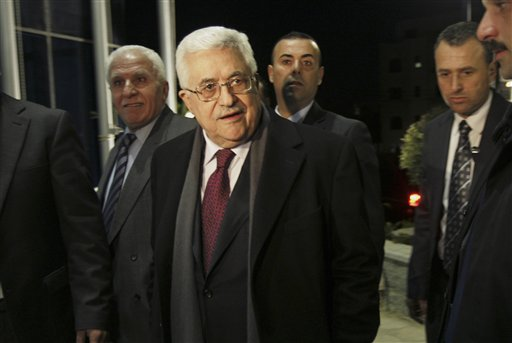 Palestinian President Mahmoud Abbas arrives at the Fatah party's executive committee meeting  at his compound in the West Bank city of Ramallah, Sunday, March 27, 2011. (AP Photo/Majdi Mohammed)