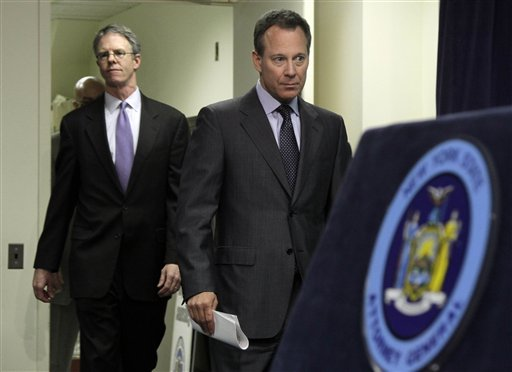 New York Attorney General Eric Schneiderman, right, accompanied by Peter Washburn, policy analyst for the attorney general's  Environmental Protection Bureau, arrives for a news conference in his New York City office,  Friday, March 18, 2011. The New York attorney general says the earthquake resistance of the Indian Point nuclear power plants should be considered in the plants' application for new 20-year licenses. Attorney General Schneiderman says federal regulators have ignored the plants' quake safety in the relicensing process. He said Friday that the Nuclear Regulatory Commission should amend its regulations to require a seismic analysis. (AP Photo)