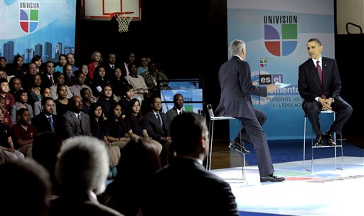 President Barack Obama with Univision news anchor Jorge Ramos, during a town hall with students, parents and teachers at Bell Multicultural High School, in the Columbia Heights neighborhood of Washington, Monday, March 28, 2011. (AP Photo/Pablo Martinez Monsivais)