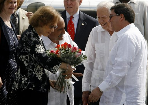 Former President Jimmy Carter, second from right, and his wife Rosalynn Carter, second from left, are welcomed by Cuba's Foreign Minister Bruno Rodriguez, right, and an unidentified protocol official upon their arrival to the Jose Marti airport in Havana, Cuba, Monday, March 28, 2011. Carter arrived in Cuba to discuss economic policies and ways to improve Washington-Havana relations, which are even more tense than usual over the imprisonment of a U.S. contractor on the island. (AP Photo/Ismael Francisco, Prensa Latina)