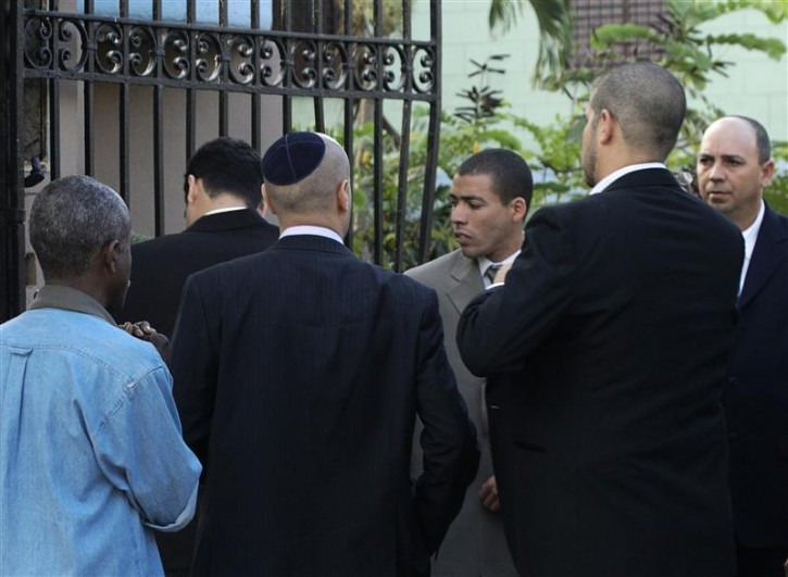 Members of the Cuban Jewish community arrive at a court during U.S. aid contractor Alan Gross' trial in Havana March 4, 2011. A U.S. aid contractor facing up to 20 years in prison was to go on trial in Cuba on Friday, accused of illegally supplying Internet gear to dissidents in a case that has spotlighted controversial U.S. activities on the communist-led island. Cuba says Alan Gross, 61, distributed sophisticated satellite communications equipment under a U.S. program that is outlawed and considered subversive by the Cuban government. REUTERS/Stringer (CUBA - Tags: POLITICS CRIME LAW)