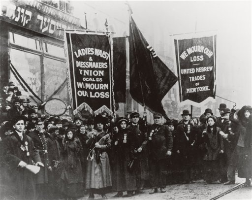 FILE - In this 1911 file photo  provided by the National Archives, labor union members gather to protest and mourn the loss of life in the March 25, 1911 Triangle Shirtwaist Factory fire in New York. One hundred years ago, horrified onlookers watched as workers leapt to their deaths from the raging fire in the garment factory. The fire killed 146 workers, mainly young immigrant women and girls, and became a touchstone for the organized labor movement, spurred fire-safety laws and shed light on the lives of immigrant workers.  (AP Photo/National Archives, File)