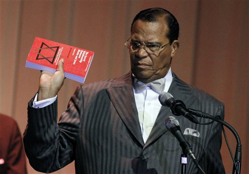 """Minister Louis Farrakhan displays the book, """"The Secret Relationship Between Blacks and Jews,"""" during his speech Friday, March 25, 2011 at Jackson State University in Jackson, Miss., as part of the 6th Annual Conference of the Veterans of the Mississippi Civil Rights Movement. Farrakhan, who leads the Chicago-based Nation of Islam delivered a speech on the need of a new grassroots movement for a change in education, and believes the book, which alleges Jews promoted a myth of black racial inferiority and accuses Jews with extensive involvement in the slave trade and in the cotton, textiles, and banking industries should be taught in schools. (AP Photo/Rogelio V. Solis)"""