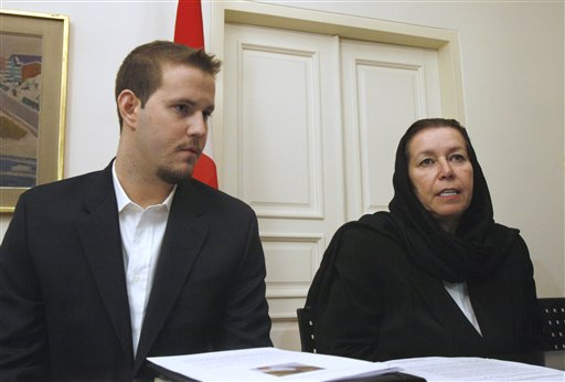 FILE - In this Dec. 22, 2007 file photo, Christine Levinson, right, the wife of missing former FBI agent Robert Levinson, and her son Daniel take part in news conference at the Swiss Embassy in Tehran. The US has proof that ex-FBI agent Robert Levinson is alive, four years after vanishing in Iran. (AP Photo/Vahid Salemi, File)