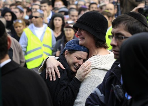 Mourners cry during the funeral of Ehud Fogel, 36, his wife Ruth, 35, and their children 11-year-old Yoav, 4-year-old Elad, and 3-month-old Hadas in Jerusalem March 13, 2011. The Jewish couple and three of their children were stabbed to death in bed in a West Bank settlement in what Israeli officials said on Saturday was an attack by one or more Palestinians who broke into their home. REUTERS/Baz Ratner