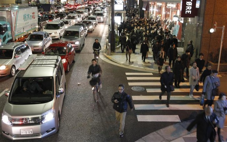 Residents walk between grid locked vehicles on their way home among chaotic traffic in central Tokyo, after an earthquake off the coast of northern Japan March 11, 2011. A massive 8.9 magnitude quake hit northeast Japan on Friday, causing many injuries, fires and a ten-metre (33-ft) tsunami along parts of the country's coastline. A tsunami warning has been issued for the entire Pacific basin except for the mainland United States and Canada following a huge earthquake that hit Japan on Friday, the Pacific Tsunami Warning Center said.  REUTERS/Toru Hanai