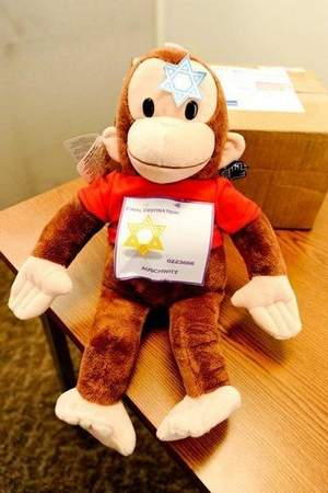 Ball, a Carmel Republican who chairs the Veterans, Homeland Security, and Military Affairs Committee, released a photo of the Curious George stuffed animal with a paper Star of David stuck to its forehead and a piece of paper pinned to the monkey's chest that reads Final Destination: Auschwitz. The paper has a seven-digit number that appears to mock the ID numbers that were tattooed onto the arms of Jewish prisoners in Auschwitz and other Nazi death camps.