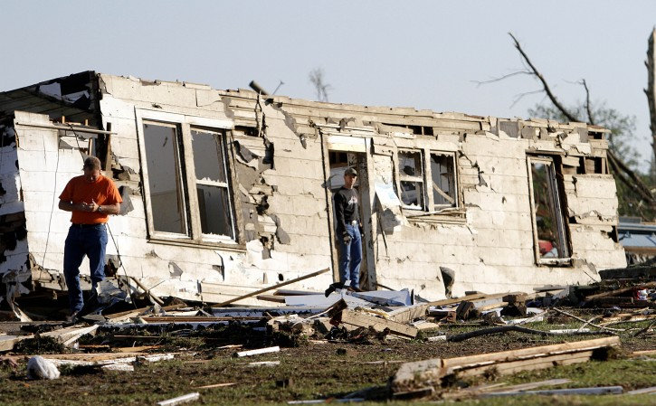 Residents search through what is left of their homes Thursday, April 28, 2011 after a tornado hit Pleasant Grove just west of downtown Birmingham, Ala., Wednesday afternoon. (AP Photo/Butch Dill)