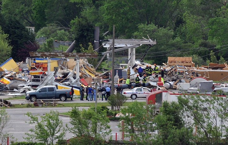 Rescue workers search a destroyed business on State Route 151 in Ringgold, Ga. Thursday morning April 28, 2011. Dozens of tornadoes ripped through the South, flattening homes and businesses and killing at least 215 people in six states in the deadliest outbreak in nearly 40 years. (AP Photo/Atlanta Journal & Constitution, Brant Sanderlin)