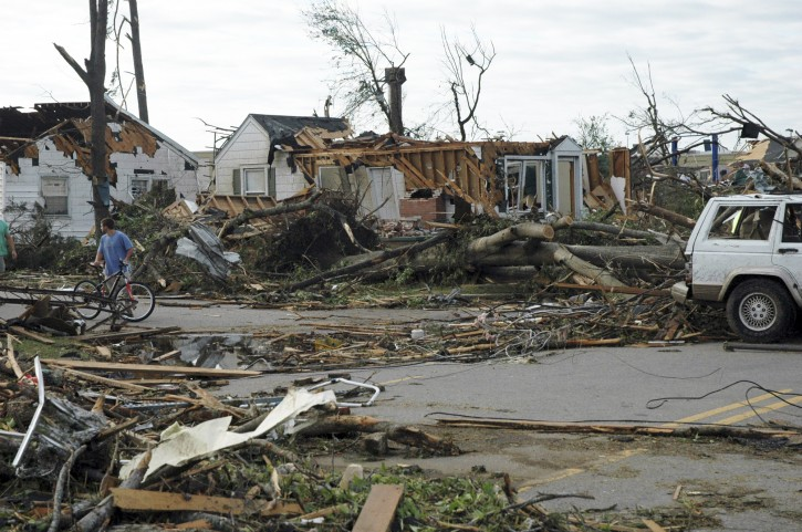 A man pauses to look at damage from a deadly tornado, on Thursday, April 28, 2011, in Tuscaloosa, Ala. The twister demolished a neighborhood and commercial area near the University of Alabama. (AP Photo/Jay Reeves)