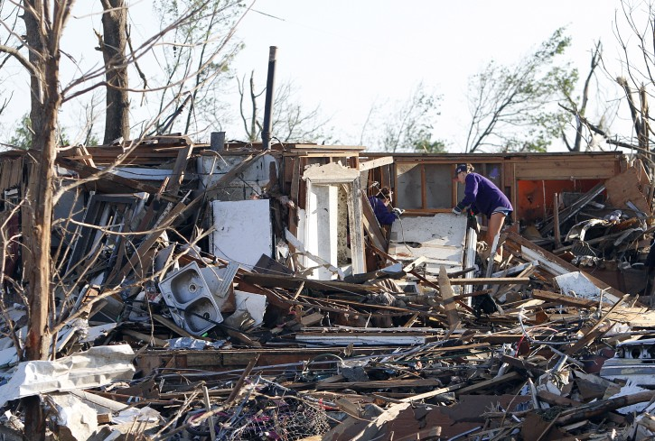 Residents search through what is left of their homes after Wednesday's tornado hit Pleasant Grove just west of downtown Birmingham, Ala., on Thursday, April 28, 2011. (AP Photo/Butch Dill)