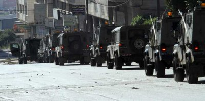 FILE - 2 Israeli troops are seen as they raid near the Joseph's Tomb site in The West Bank City of Nablus on 24 April 2011. EPA