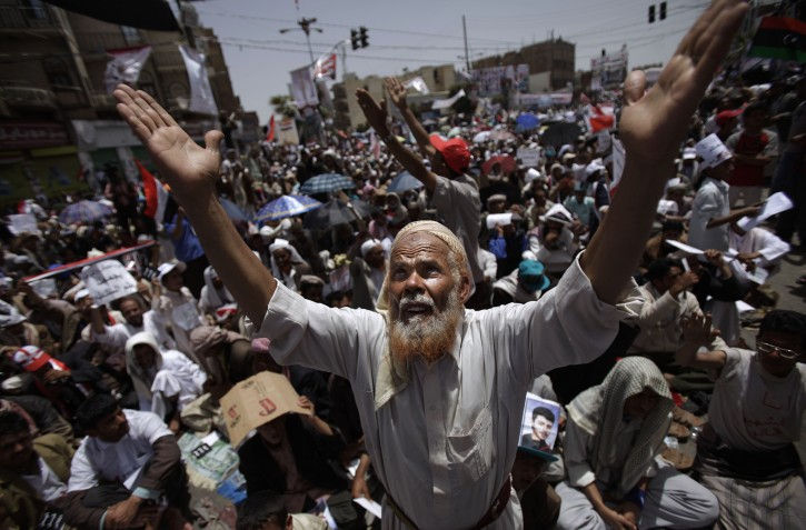 An elderly anti-government protestor chants prayers during a demonstration  demanding the resignation of Yemeni President Ali Abdullah Saleh, in Sanaa,Yemen, Friday, April 1, 2011. Hundreds of thousands of Yemenis have packed a main square in the capital and are on the march elsewhere across the nation, demanding the country's ruler of 32 years step down.  (AP Photo/Muhammed Muheisen)