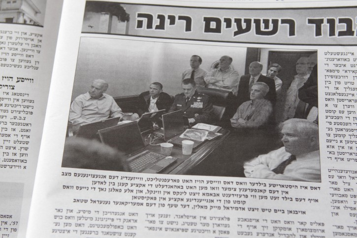 """A photograph of President Barack Obama and his staff watching the operation that killed Osama bin Laden that was digitally altered to remove Secretary of State Hillary Clinton and Counterterrorism Director Audrey Tomason is shown in last week's edition of the Brooklyn weekly Di Tzeitung, Monday May 9, 2011. The Orthodox Jewish newspaper has apologized for digitally altering the photo, saying that its photo editor had not read the """"fine print"""" accompanying the White House photo that forbade any changes. (AP Photo/Seth Wenig)"""