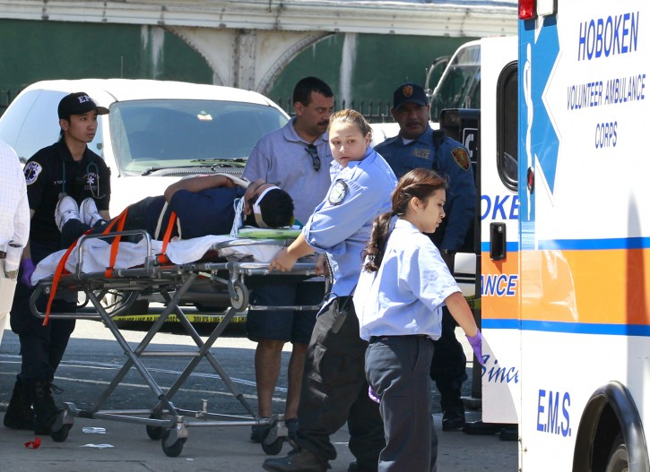 An unidentified man, who was injured during a PATH train crash at the Hoboken Terminal, is seen on a stretcher as medical officials prepared to take him to the hospital, Sunday, May 8, 2011, in Hoboken, N.J. A spokesman says a train pulling into the station struck an abutment, causing minor injuries. (AP Photo/Julio Cortez)