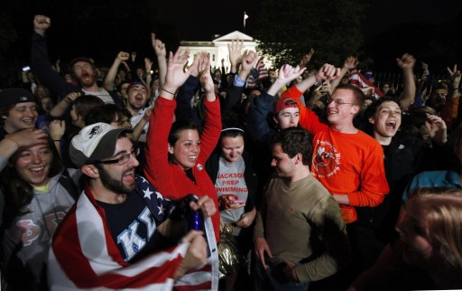 A crowd outside the White House in Washington, cheer Sunday, May 1, 2011, upon hearing the news that terrorist leader Osama bin Laden is dead. (AP Photo/Manuel Balce Ceneta)